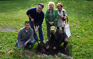 Mayor Mike Savage, Councillor Gloria McCluskey, and Tree Canada's Bruce Carter plant a cherry shrub with Halifax Diverse Program Coordinator, David Foster