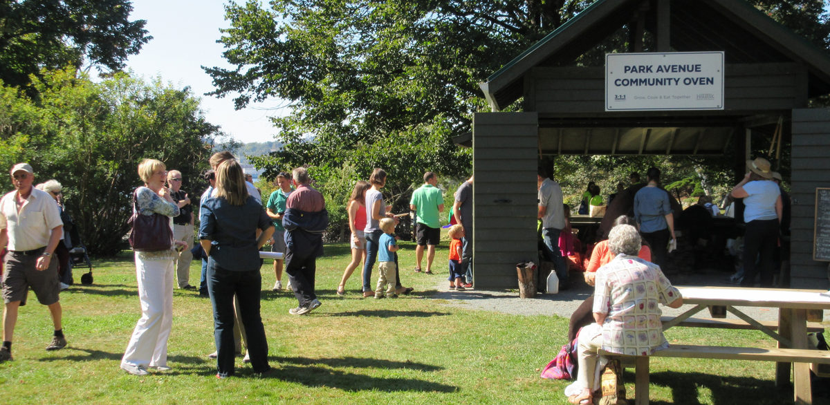Park users of the Dartmouth Common enjoy the community oven